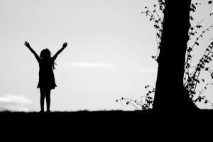 Girl spreading arms in joy